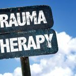 Trauma Therapy sign with sky background